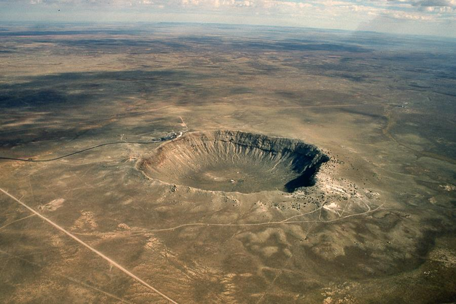 Barringer crater seen from the air surrounded by desert