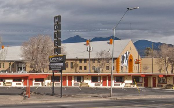 Canyon Inn neon sign and Cow Mural, Flagstaff
