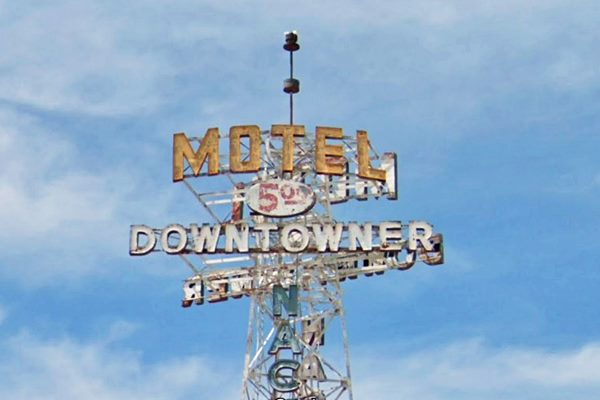 neon sign on top of a tower, Downtowner Motel