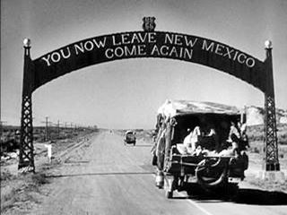A still from The Grapes of Wrath, the Route 66 archway Lupton AZ state line