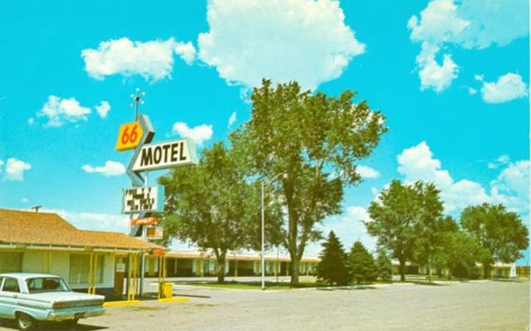 66 Motel and neon sign in 1960s postcard