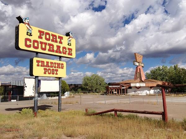 """The octogonal shaped """"Pancake House"""" next to Fort Courage, Houck AZ, and the sign."""