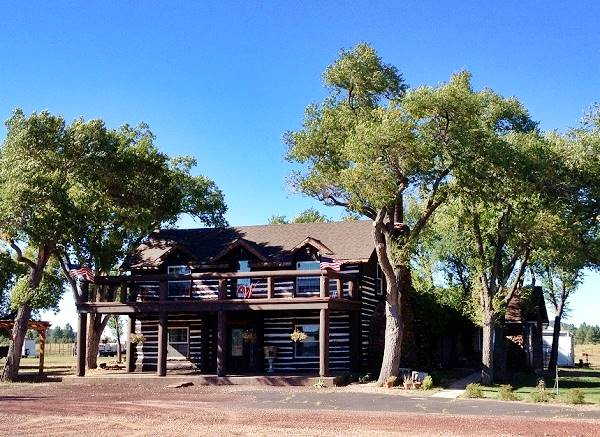 Street View of the Wagon Wheel, a two story log cabin in Parks, Arizona, Route 66