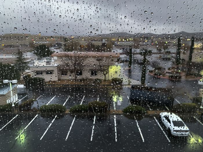 rain on the hotel windows on rainy dull day