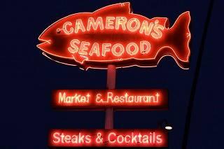 fish-shaped neon sign at Cameron's