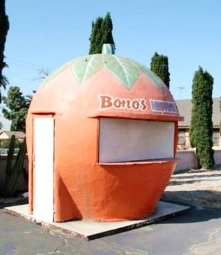 giant orange-shaped fruit stand at Bono's, Fontana
