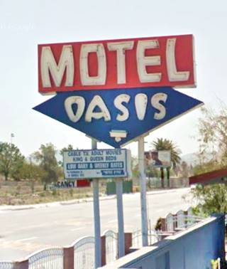 the neon sign of Oasis Motel San Bernardino