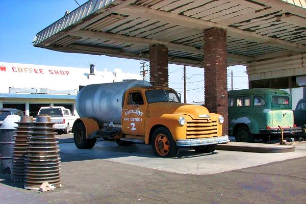 Vintage trucks at former Ritchfield service station in Ludlow, Route 66 California