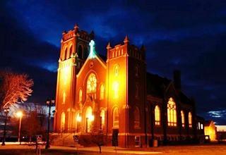 Blue neon cross at Hamel's Lutheran church