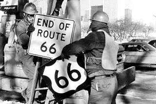 Route 66 shield being removed, Jan 1977 in Chicago US66