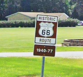 Historic 1940-1977 US 66 road sign in Livingston US66