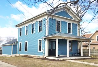 Pale blue former 1851 school which is now the Plainfield Inn