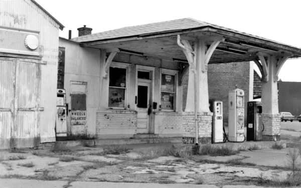 black and white photo of the closed gas station