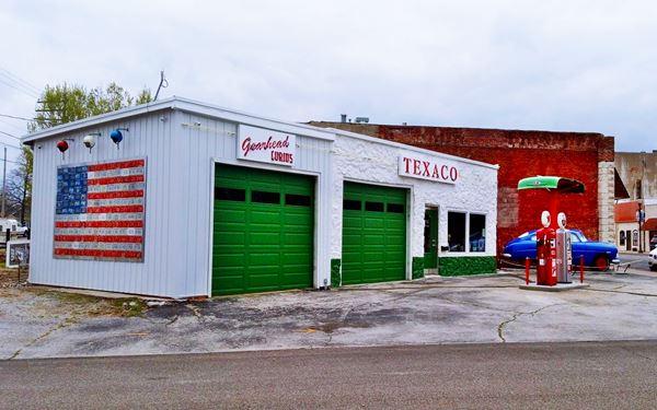 restored former Texaco, garage, pumps, office and Doc Hudson