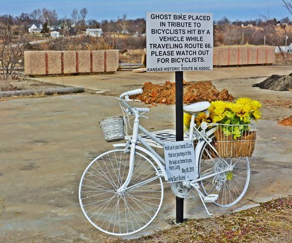 white bike in remembrance of two cyclists killed in an accident on US66