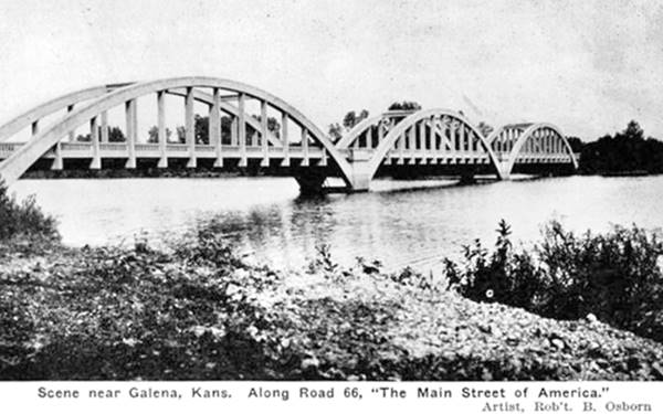 black and white photo of bridge with three arches across a river