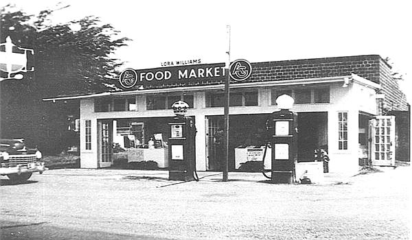 A 1950s view of gas station, store and car