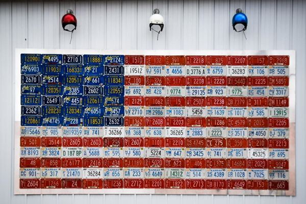 us flag made with licence plates on a wall