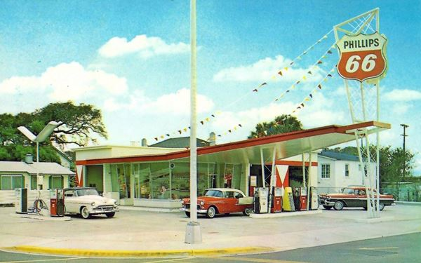 color photo 1950s cars, and bat wing Phillips service station
