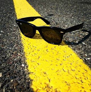 Sunglasses and road surface