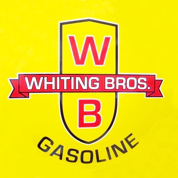 The yellow and red Whiting Bros. shield and logo
