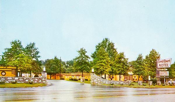 Coral Court Motel entrance gate in vintage postcard