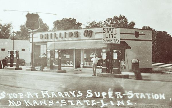 vintage 1940s Phillips 66 gas station, black and white photo