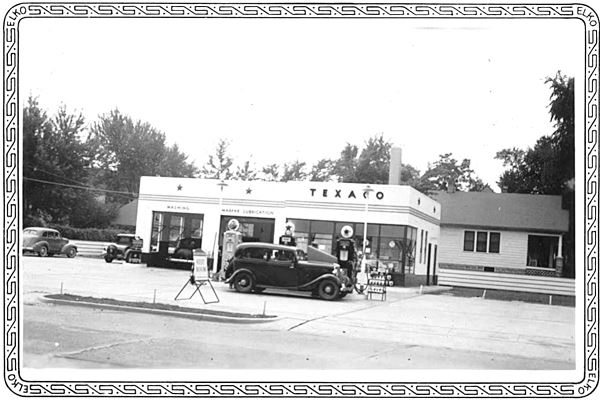 vintage 1930s cars at a Texaco, black and white photo
