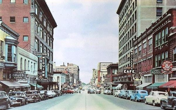 1940s color photo with cars, buildings and signs