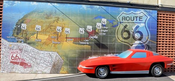 Mural with Route 66 shield, map and a 3-D car