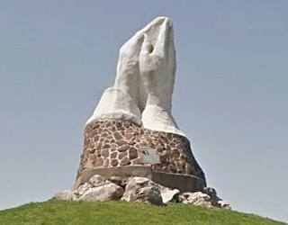 Giant Praying Hands statue
