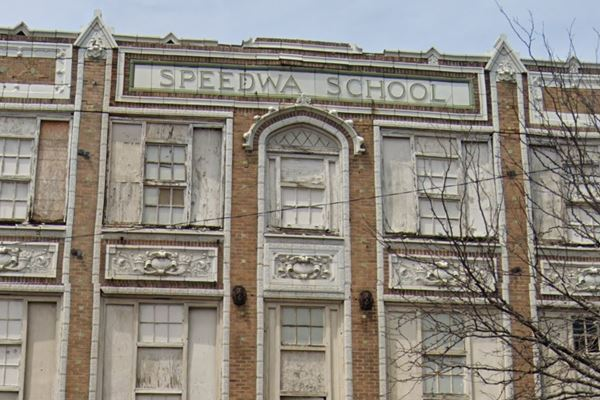 facade of the old school with its name