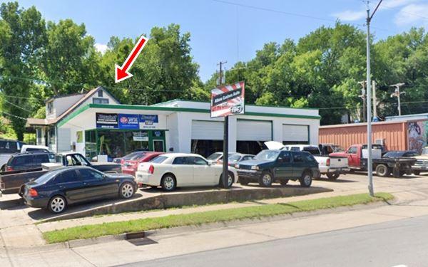 vintage gas station on corner, trees, cars and garage