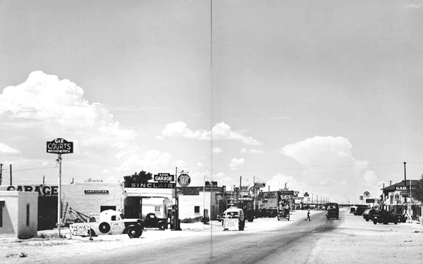 black and white photo from 1947: cars, cafes, gas stations on Route 66