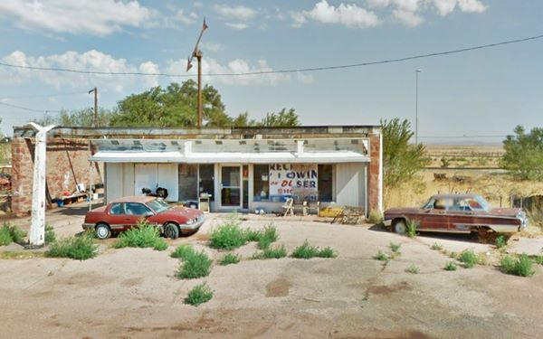 abandoned Texaco, with old rusty cars