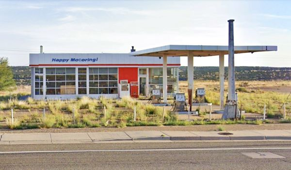 classic Esso gas Station, with office, canopy and large windows on garage bays