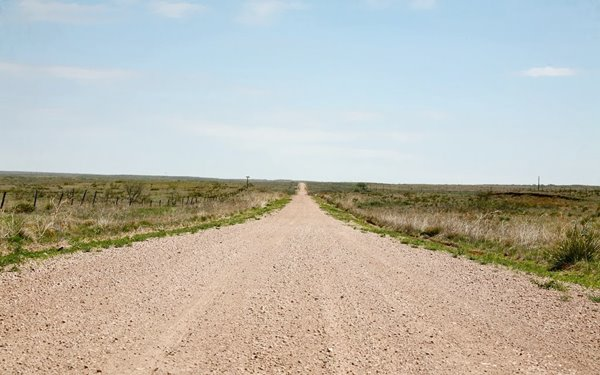 Dirt road in the open green countryside