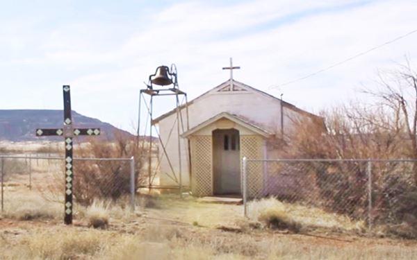 church, cross and external bell