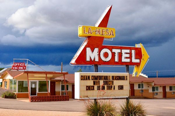 classic neon sign in red and yellow of La Mesa Motel