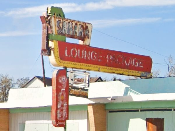 neon sign of the cafe and bar