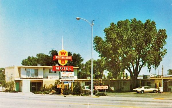 postcard with the Whiting Bros motel and neon sign