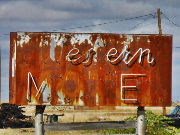 Western motel's rusty neon sign