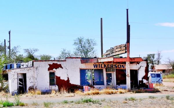 ruins of an abandoned gas station in Newkirk, New Mexico