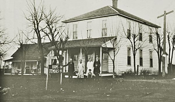 black and white photo of the hotel with some people