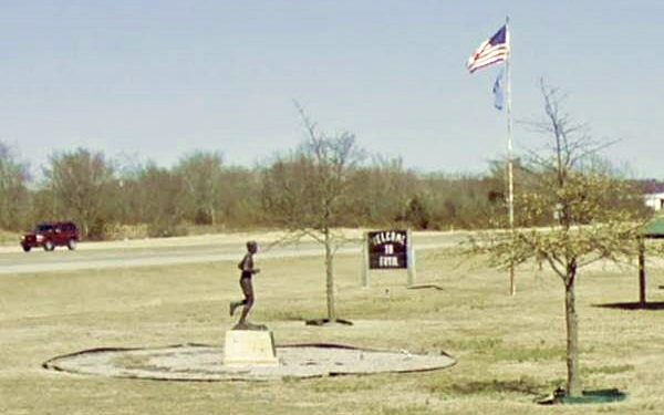 Payne monument in a park by Route 66 in Foyil