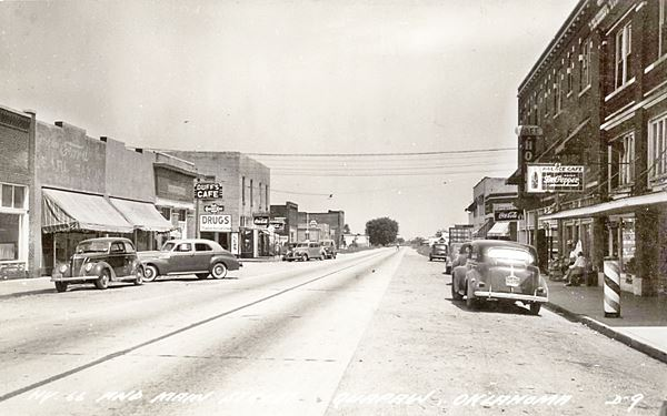Main Street, looking north, Quapaw, buildings and cars c.1930s