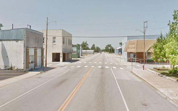 Main Street, looking north, Quapaw, buildings and cars c.2013