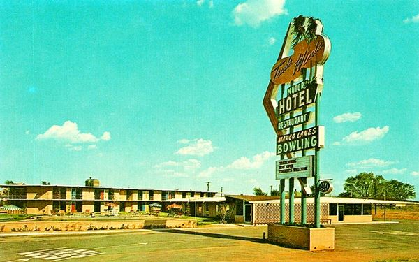 Trade Winds motel and neon sign color postcard