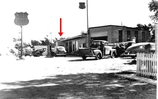 old cars at pumps, Phillips 66 and cafe sign, black and white picture circa 1940s