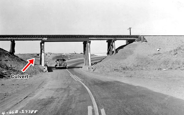 car in the underpass on US66 black and white 1940s photo